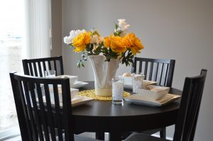 yellow flowers at dining room table